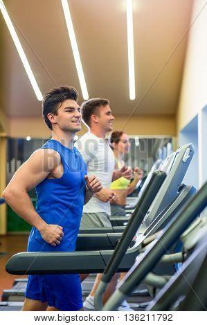 Running people on a treadmill