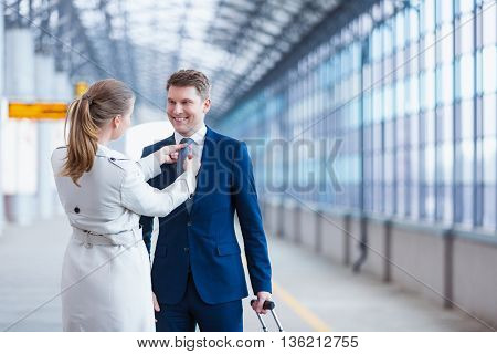 Smiling couple at station