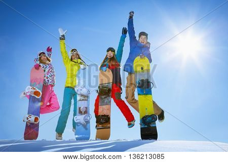 Jumping people with snowboards outdoors