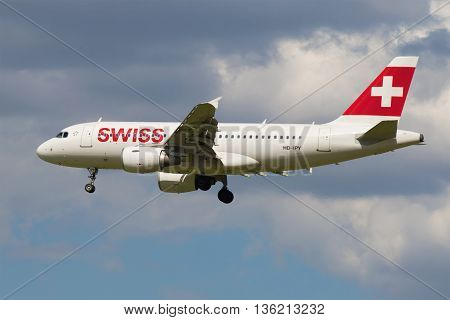 SAINT PETERSBURG, RUSSIA - MAY 17, 2016: The Airbus A319-112 (HB-IPY) Swiss International Airlines on the background of cloudy sky