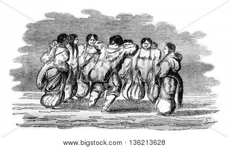 Eskimos a leading women's dance, vintage engraved illustration. Magasin Pittoresque 1836.