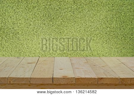 wood table top on artificial grass for football field background