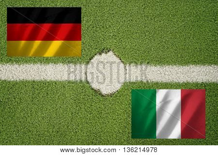 germany and italy flag on football green field and haft line
