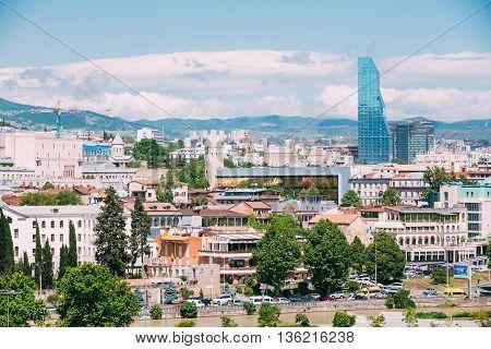Tbilisi Georgia - May 19 2016: Radisson Blu Hotel On Background Of Urban Cityscape Of Tbilisi Georgia
