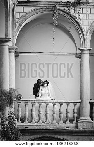 Wedding Couple On Italian Courtyard