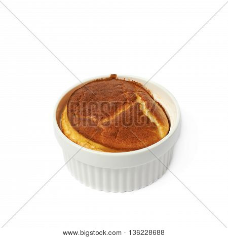 Cheese souffle in a white ceramic ramekin, composition isolated over the white background