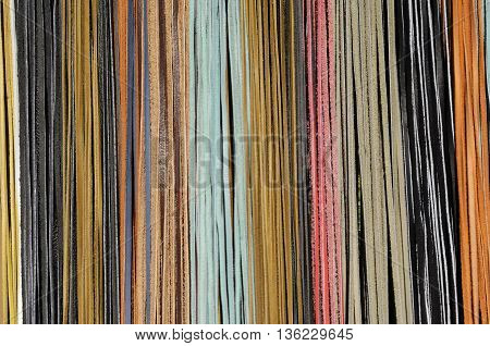 Detail of a courtain of coloured leather