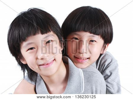 Portrait of two boys, twins isolated on white.