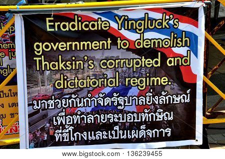 Bangkok Thailand - January 15 2014: Sign in English and Thai espouses bringing down the government of Yingluck Shiniwatra at Operation Shut Down Bangkok