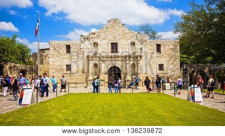 SAN ANTONIO, TEXAS - APRIL 15: Tourists visit the historic Alamo in downtown San Antonio, Texas on April 15th, 2016.