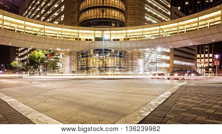 Busy intersection in downtown Houston Texas at night with traffic