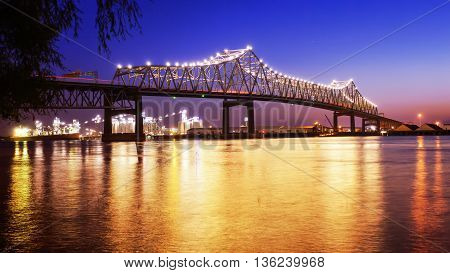 Horace Wilkinson Bridge crosses over the Mississippi River at night in Baton Rouge Louisiana