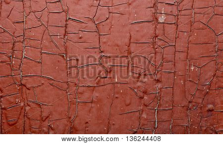 Red Painted old wall. Abstract cracked brown texture.