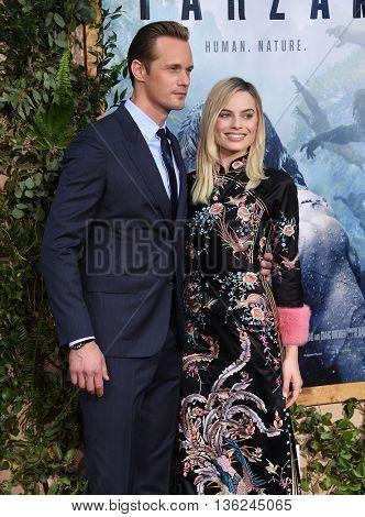 LOS ANGELES - JUN 27:  Alexander Skarsgard & Margot Robbie arrives to the