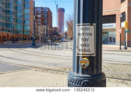 JERSEY CITY, NJ - CIRCA MARCH, 2016: close up shot of push button for walk signal in Jersey City at daytime. Jersey City is the second most populous city in the U.S. state of New Jersey after Newark.