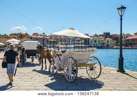 Chania, Crete - 23 Maj, 2016: Horse Carriage For Transporting Tourists In Old Port Of Chania On Cret