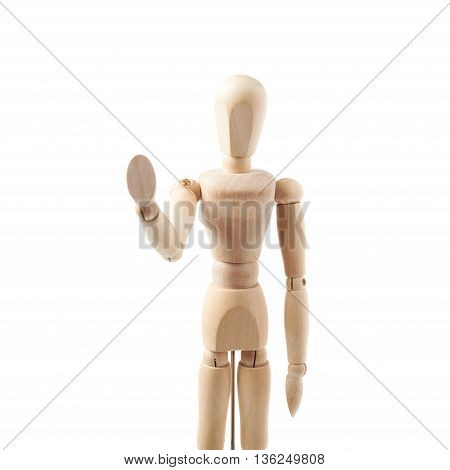 Made of wood human doll puppet statuette show a stop sign gesture, composition isolated over the white background
