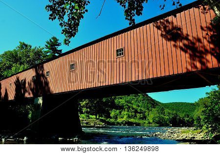 West Cornwall Connecticut - September 15 2014: The 1864 West Cornwall Covered Bridge. also known as Hart Bridge is a wooden lattice truss bridge over the Housatonic River *