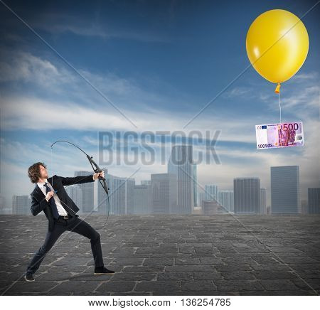 Businessman with arch pointed banknote attached to a balloon