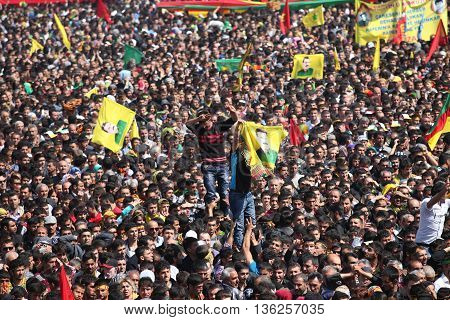 DIYARBAKIR,TURKEY - MARCH 21: Kurds celebrating their traditional feast Newroz that means 'new day' in kurdish on March 21, 2013 in Diyarbakir, Turkey.