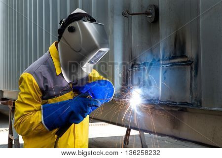 Industry Worker Welding concept - Industry worker with welding steel to repair container structures manufacture workshop.