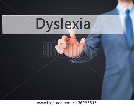 Dyslexia - Businessman Hand Pressing Button On Touch Screen Interface.