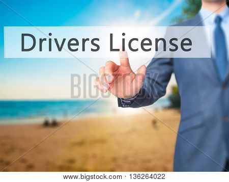 Drivers License - Businessman Hand Pressing Button On Touch Screen Interface.
