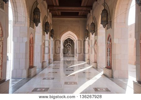 Muscat Oman - February 28 2016: Archway at Sultan Qaboos Grand Mosque in Muscat Oman. This is the largest and most decorated mosque in this mostly Muslim country.