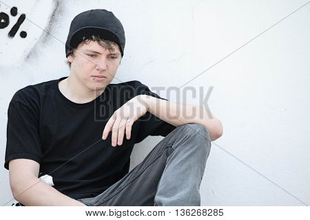 sad depressed lonely adolescent teen boy