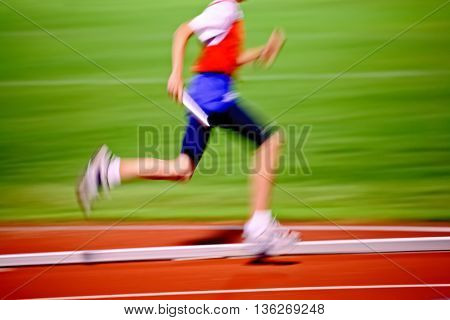 Motion blurred relay race, MOTION BLURRED.  Track and Field