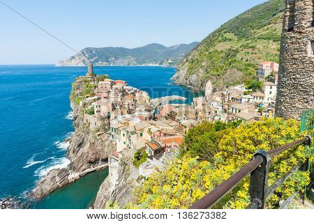Colorful Italian village Vernazza constructed on top rock outcrop jutting into Mediterranean sea.