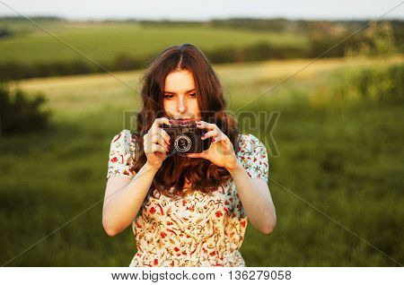 Retro Photo Camera Woman With Red Hair. Portrait Of A Woman With