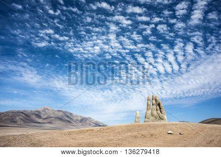 Antofagasta April 6: Rains in the Atacama Desert washed away graffiti from the sculpture Hand of Desert (Mano de Desierto) April 6 2014 in the Atacama Desert near Antofagasta Chile