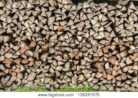 Stack Of Firewood Stapled On A Meadow