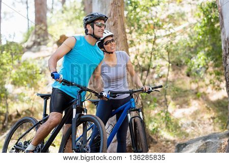 Couple looking something on their bikes