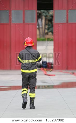 Firefighters in uniform in the firehouse during training time