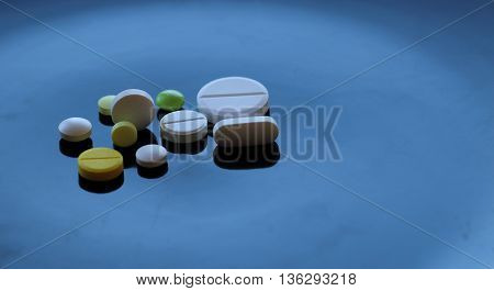 Colorful types of tablet pills detailed stock photo