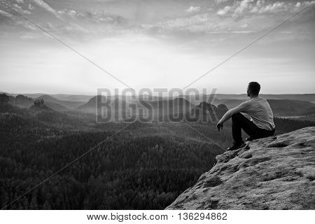 Tourist Watching Sunrise Above  Misty Hilly Valley