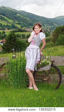 Portrait of a young Bavarian woman in dirndl.