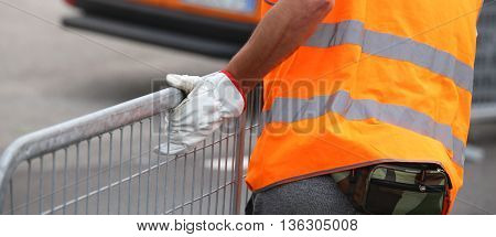 Worker With High Visibility Reflective Jacket And Gloves