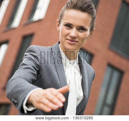 Portrait Of Modern Business Woman Stretching Hand For Handshake
