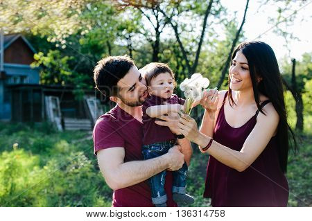 young family on the nature in the countryside
