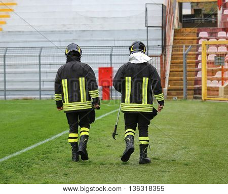 Two Firefighters With Helmet For The Security Service