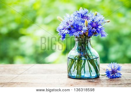 Summer bouquet of blue cornflower outdoors with copy space.
