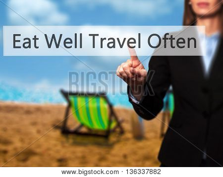 Eat Well Travel Often - Businesswoman Hand Pressing Button On Touch Screen Interface.