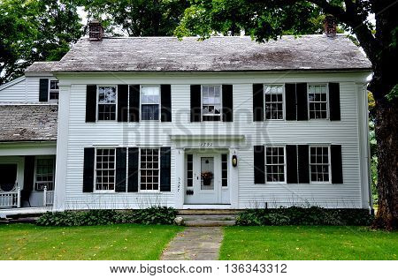 West Arlington Vermont - September 19 2014: 1792 Inn on the Covered Bridge Green is a classic white clapboard New England home