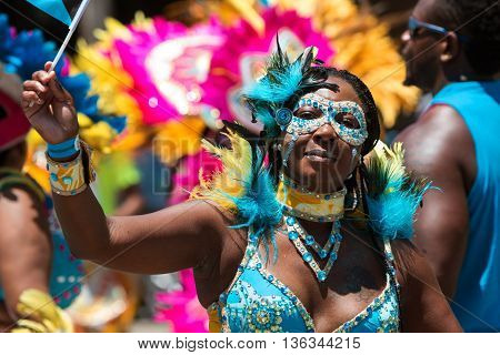 ATLANTA, GA - MAY 2016:  A woman wearing an elaborate costume and mask participates in a parade celebrating Caribbean culture on North Avenue in Atlanta GA on May 28 2016