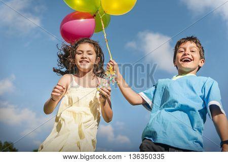 Happy Boy Girl Dozen Helium Balloons Playful Concept