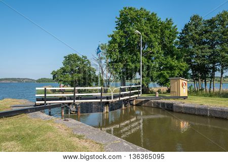 MEM, SWEDEN - JUNE 25, 2016: The first lock at Gota Canal in Mem during midsummer in Sweden. Mem is the gate to Gota Canal from the Baltic sea on the east coast of Sweden.