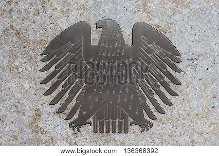 Berlin Germany - June 29 2016: The german eagle (Bundesadler) the logo of the German Bundestag at the Bundestag building.
